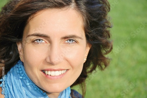 closeup attractive woman with blue eyes