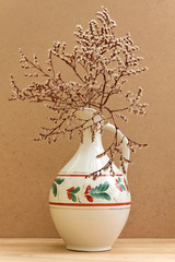 Vintage pitcher with dried branch