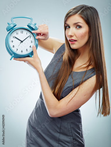 Portrait of business woman holding watch.