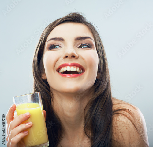 Young woman close up portrait drink juice
