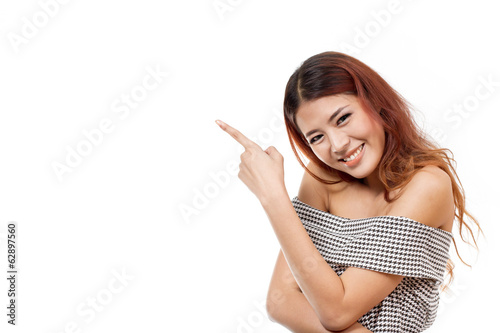 happy, smiling, positive, woman pointing at blank space