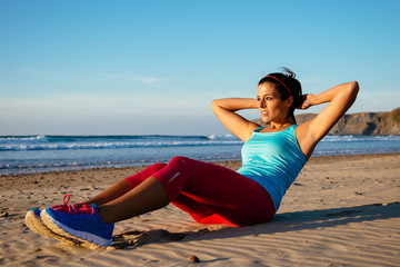 Fitness woman sit ups exercising