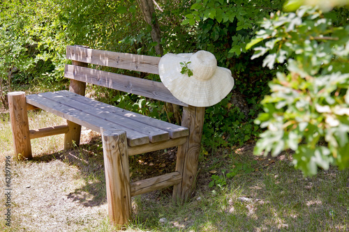 Sunhat on a wooden garden bench.