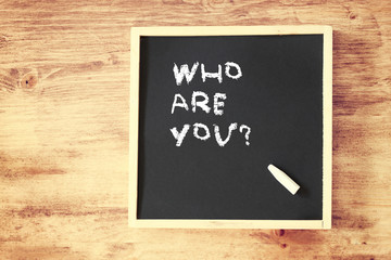 chalkboard with the phrase who are you written in chalk