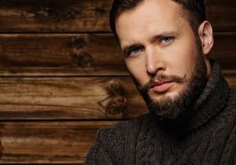 Handsome man wearing cardigan