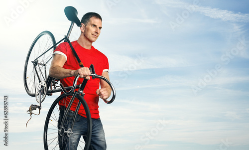 Portrait of a man with classic fixed gear bicycle