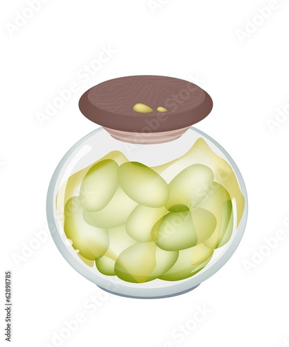 Green Olives in A jar on White Background