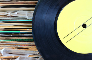 close up of old record and records stack.