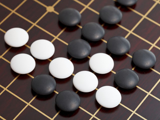 above view of stones during go game playing