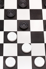 position on black and white draughts board