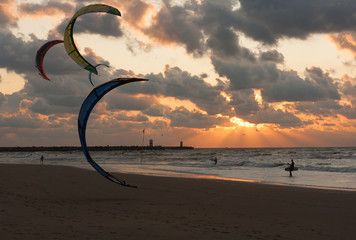 Kite surfing in the sunset at the Dutch beach of Scheveningen