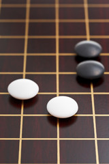 black and white stones during go game
