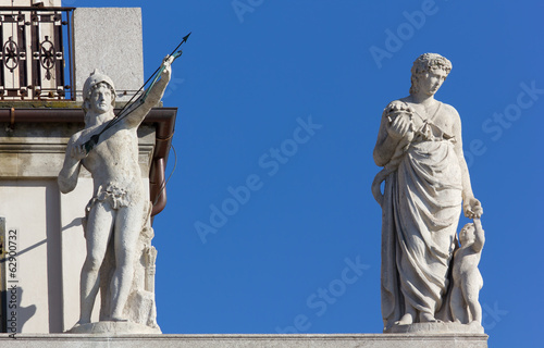 Two Neoclassic Statues on a Palace in Trieste, Italy