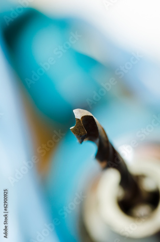 metal old used drill bit on blur backgrounds