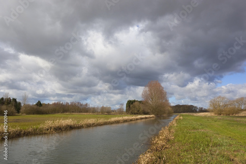 storm clouds over canal