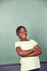 Smiling african girl in school