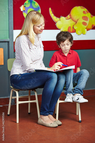 Student learning in private lessons with teacher