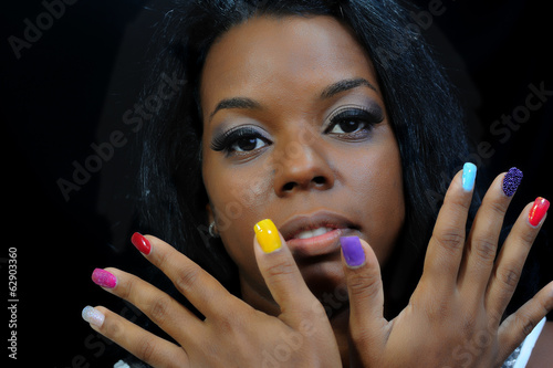 mulatto girl with colorful fingernails