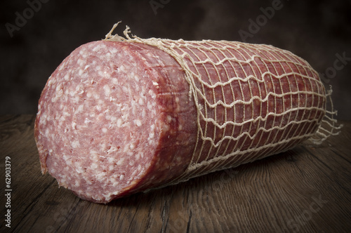 Salami close up on the wood table