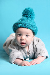 cute baby in blue hat with a pompon