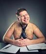 Smirking shirtless businessman studio image