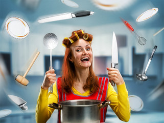 Happy smiling housewife with flying kitchen tools