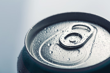 Aluminum can with water drops isolated on gray