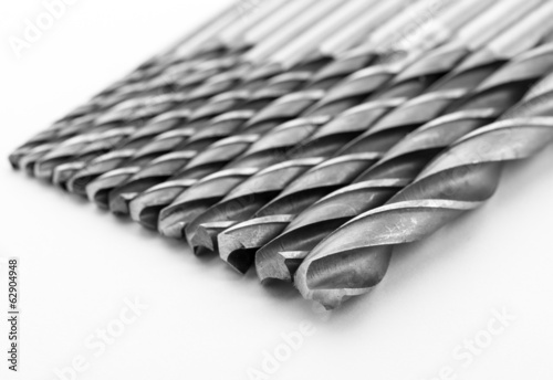 Line of drill bits isolated on white