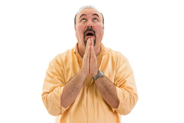 Middle-aged man praying to heaven for help