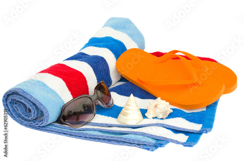 beach striped  towel and sandals