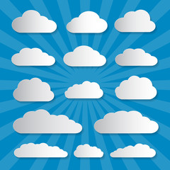 Vector Clouds Cut From Paper on Blue Background