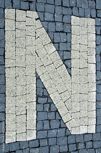 Sidewalk made of stones with letters
