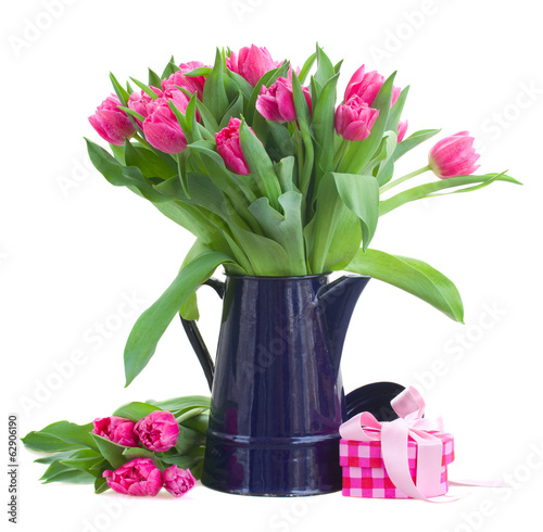 bouquet of pink tulips in blue pot