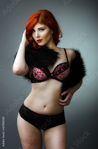 Sensual plus size model posing in sexy lingerie