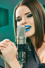 Close up beautiful woman singer portrait.