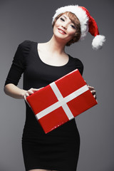 Model fashion woman hold Christmas gift. Santa woman.