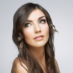 Woman face close up beauty portrait. Girl with long hair lookin