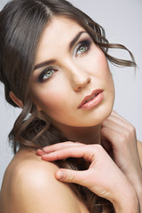 Woman beautiful face portrait. Skin care style face hand touchi