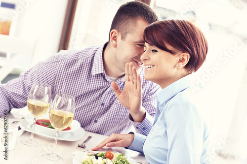 canvas print picture Happy couple in a restaurant