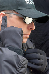 Close Protection Listens To Earpiece