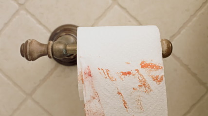Toilet paper bloody hand taking sheet