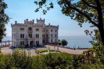 Miramare castle and gardens with vegetation frame