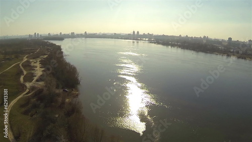 Suburban landscape with river and sunlight, Ukraine. Aerial