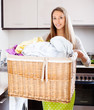 Young woman with large linen basket