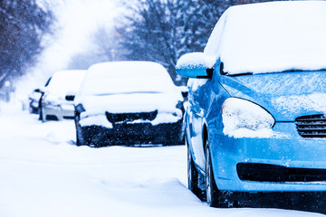 Parked Cars on a Snowstorm Winter Day