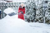 Fototapety Woman Shoveling her Parking Lot