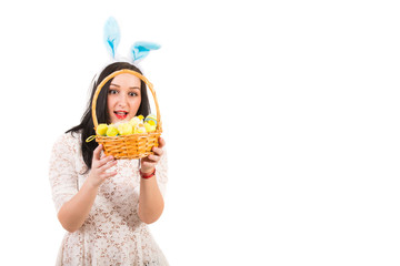 Amazed woman looking in Easter basket