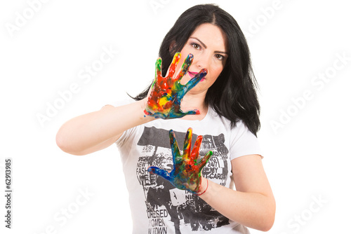Woman showing hands in paints