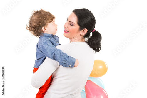 Back of mother and son with balloons