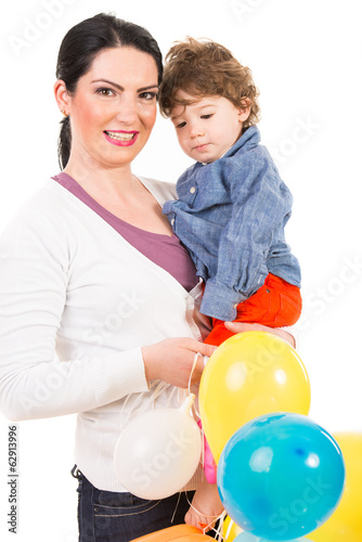 Happy mother and son with balloons